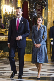 Queen Letizia of Spain completed her look with a pair of navy suede pumps.