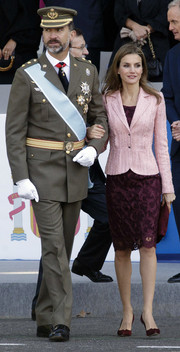 Princess Letizia wore a pink tweed jacket over a purple lace dress for the National Day Military Parade.