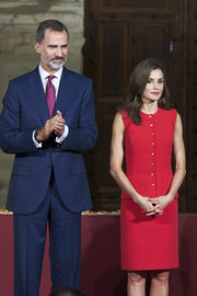 Queen Letizia of Spain cut a sleek silhouette in a sleeveless red skirt suit by Nina Ricci at the National Culture Awards.