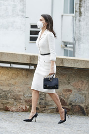 Queen Letizia of Spain teamed a black chain-strap bag by Nina Ricci with a white tweed dress for the opening of the Helga de Alvear Museum.