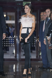 Queen Letizia of Spain dolled up in a feather-embellished tube top by The 2nd Skin Co. for the 2019 Princess of Asturias Awards concert.