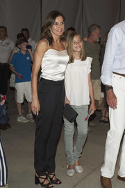 Queen Letizia of Spain attended a concert in Palma de Mallorca wearing a white silk camisole.
