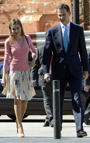 Princess Letizia looked sweet and youthful in a pink cardigan while visiting the new Puig headquarters.