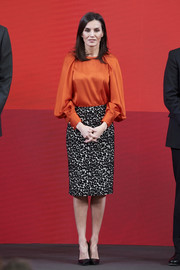 Queen Letizia paired a loose orange blouse by Zara with a leopard-print pencil skirt for the promotion of Honorary Ambassadors for 'Spain' brand.
