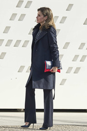 Queen Letizia of Spain headed to the Merit in Fine Arts ceremony wearing a stylish fur-collar wool coat by Hugo Boss.