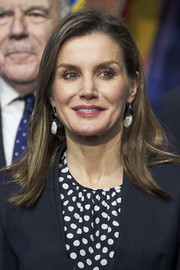 Queen Letizia of Spain wore her hair straight with an off-center part and a slight flip at the ends during the Merit in Fine Arts ceremony.