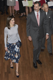 Queen Letizia of Spain paired a gray crewneck sweater with a floral skirt to deliver the La Caixa scholarships.