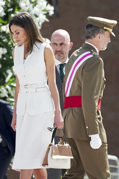 Queen Letizia of Spain attended a Central Academy of Defense event carrying a color-block bag by Carolina Herrera.