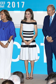 Queen Letizia of Spain looked fetching in a monochrome striped off-the-shoulder dress by Carolina Herrera at the 2017 UNICEF Awards.