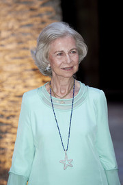 Queen Sofia accessorized with a whimsical star pendant necklace for a dinner in Palma de Mallorca.