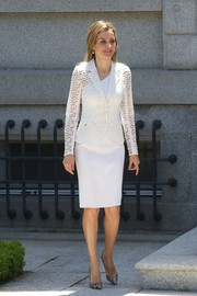 Princess Letizia styled her white outfit with a pair of taupe snakeskin pumps.
