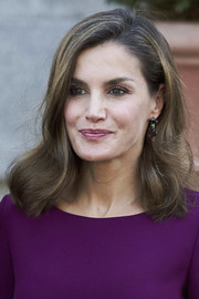 Queen Letizia of Spain paired her lovely hairstyle with elegant gemstone drop earrings.