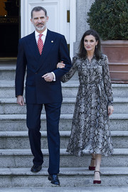 Queen Letizia of Spain hosted an official lunch for the President of Peru wearing a stylish snakeskin-print shirtdress by Massimo Dutti.