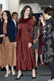 Queen Letizia of Spain kept it ladylike in a red print midi dress by Maje at the ARCO Fair 2020.