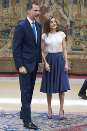 Queen Letizia of Spain completed her ensemble with blue suede platform pumps.