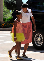 Sasha Obama looked super cute from her top-knot all the way down to her gold ballet flats.