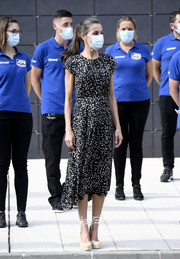 Queen Letizia of Spain donned a spotted black-and-white midi dress by Massimo Dutti for her visit to the Fernando Alonso Museum.