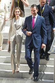 Princess Letizia looked flawless in a perfectly tailored beige pantsuit while visiting an exhibition.