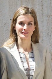 Princess Letizia attended an Archaeological Museum exhibition wearing her hair in a simple straight style.