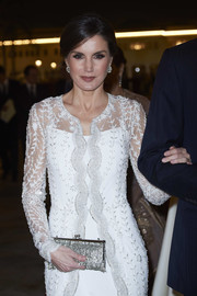 Queen Letizia of Spain accessorized with a dazzling crystal-encrusted clutch while attending a gala dinner at the Royal Palace in Morocco.