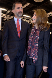 Princess Letizia spruced up a simple charcoal pantsuit with a patterned scarf for the Anuga trade fair.