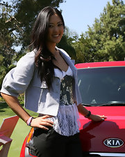 Michelle Wie tamed her frilly lace peplum top with a gray cropped jacket during the Kia Classic LPGA press conference.