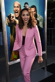 Amber Stevens West went for modern styling with this iridescent gold clutch at the special presentation of 'Keanu.'