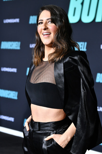 More Pics of D'Arcy Carden Pantsuit (1 of 3) - D'Arcy Carden Lookbook - StyleBistro [bombshell,clothing,abdomen,black hair,trunk,brown hair,long hair,smile,premiere,leather,crop top,red carpet,darcy carden,screening,california,regency village theatre,special screening of liongate,westwood]