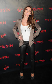These leather leggings toughened up Audrina's sleek look at the premiere of 'The Raven' in LA.