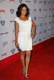Sanaa dressed up her day dress with strappy metallic evening sandals.