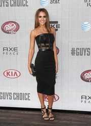 Jessica Alba accessorized her outfit with a simple black hard-case clutch by Diane von Furstenberg.