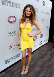 Chrissy Teigen showed major cleavage and leg in a yellow strapless mini by Three Floor, featuring see-through panels and a sexy curved hem, during Spike TV's Guys Choice 2014.
