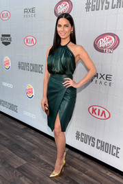 Olivia Munn injected some edge into her look with a wrap-style green leather skirt, also by J. Mendel.
