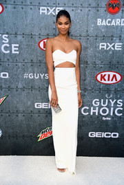 Chanel Iman styled her gown with a luxurious crystal clutch.
