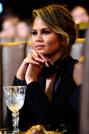 Chrissy Teigen watched Spike TV's Guys Choice 2016 wearing her hair in an elegant loose updo.