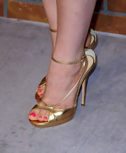 Katie Featherston showed off her glamorous side in a gold pair of evening sandals.