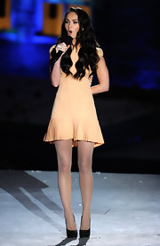 "Megan Fox charmed in a peach cocktail dress with a pleated hem at the 2010 ""Spike TV"" Scream show."