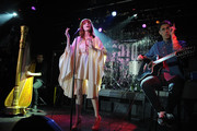 (L-R) Harpist Tom Monger, singer Florence Welch and guitarist Robert Ackroyd of Florence and the Machine perform during Spin's 2010 Year in Music party at Don Hill's on December 15, 2010 in New York City.