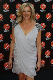 Sally Gunnell looked divine at the Sport Industry Awards in a gray draped dress with beaded shoulder detailing.
