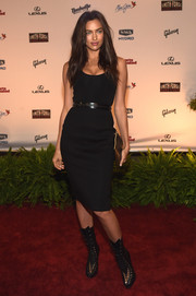 Irina Shayk styled her simple dress with fierce black lace-up boots.