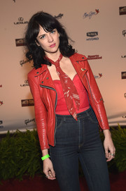 Nikki Lane went for a cowgirl-with-an-edge look with this red leather jacket, bustier, and high-waisted jeans combo at the SI Swimsuit Takes Over the Schermerhorn event.