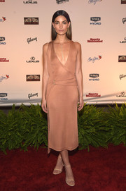 Lily Aldridge flashed some cleavage in a low-cut nude Calvin Klein wrap dress at the SI Swimsuit Takes Over the Schermerhorn Symphony Center event.
