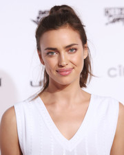 Irina Shayk looked youthful and demure with her girl-next-door ponytail at the Sports Illustrated Swimsuit 2016 celebration.