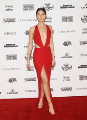 Lily Aldridge added extra sizzle with a pair of red and silver strappy sandals.