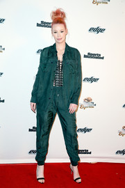 Iggy Azalea suited up in this sporty green ensemble for the SI Experience Friday Night Party.