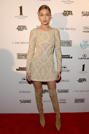 Gigi Hadid chose beige suede over-the-knee boots by Le Silla to finish off her look.