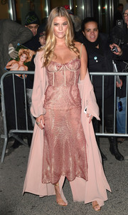 Nina Agdal arrived for the Sports Illustrated Swimsuit 2017 launch wearing a dusty-pink Cinq à Sept duster over a corset dress.