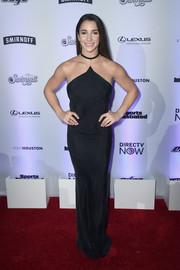 Aly Raisman hit the Sports Illustrated Swimsuit 2017 NYC launch wearing a slinky black halter gown.