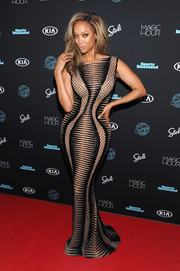 Tyra Banks enhanced an already curvy figure with this beaded optical-illusion gown by Labourjoisie for the Sports Illustrated Swimsuit 2018 launch event.