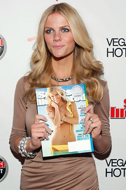 A nude dress is meant to be accessorized! Brooklyn Decker did so with this gunmetal choker.